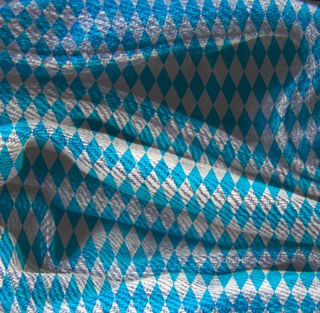 Oktoberfest bavarian traditional blue and rhombus background pattern. Grunge Fiber Texture. Grainy texture of weaving fabric.