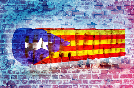 autonomía: Catalonia word textured by flag of the Catalonia flag. Old brick wall texture
