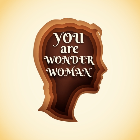 Face side view. Elegant silhouette of a female head. Short hair. Illustration with paper cut shapes. You are wonder woman text