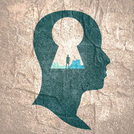 Keyhole in the head of man with woman silhouette. Banco de Imagens