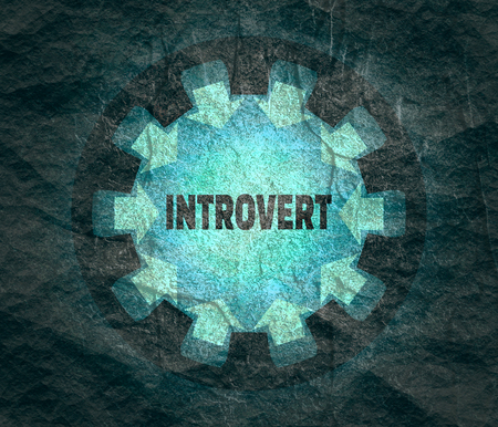Introvert word. Psychology concept. Gear with ray style arrows Zdjęcie Seryjne