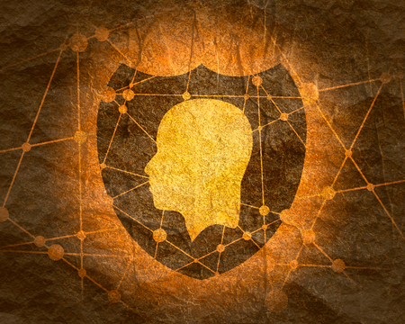 Abstract polygonal shield with human head silhouette.