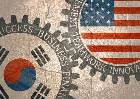 Partnership concept. USA and South Korea association. Gears textured by flag. Business relative words on the mechanism of gears. Communication concept in industrial design.