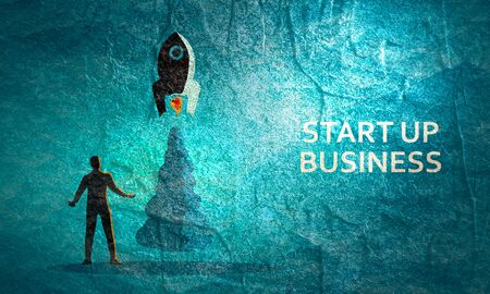 Businessman and space rocket launch as metaphor of start up project Stock Photo