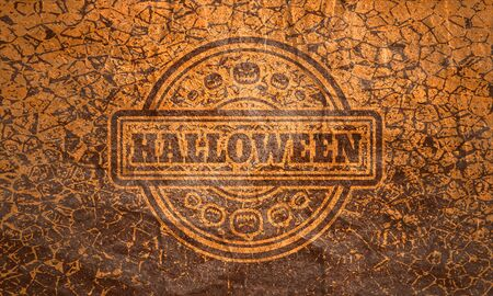 Stamp with Halloween text and pumpkins icons on cracked grunge background Reklamní fotografie