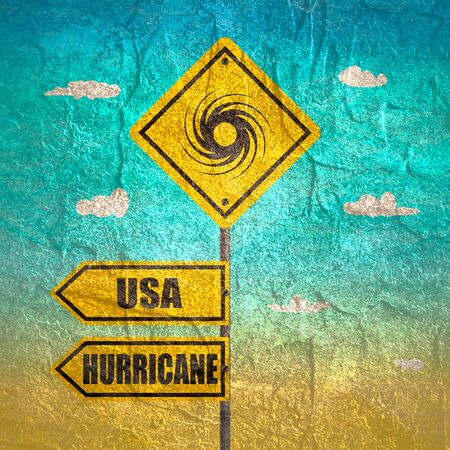 Road Sign Warning About Tornado. Twister Hurricane Countryside Wind Swirl. Road Arrows with USA and Hurricane Words Stock Photo