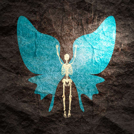Human skeleton posing with wings of butterfly Stockfoto