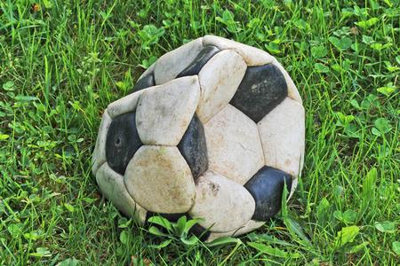 old deflated soccer ball