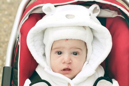 Baby with cap in winter Reklamní fotografie