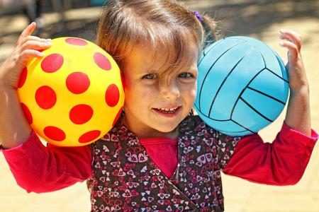 winning mood: Girl with two balls