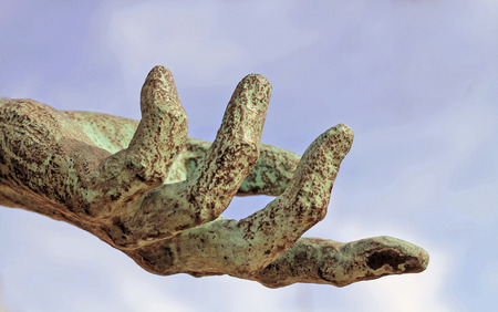 mercy: Hand and sky Stock Photo