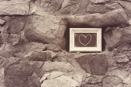 february 14th: Heart on the wall Stock Photo