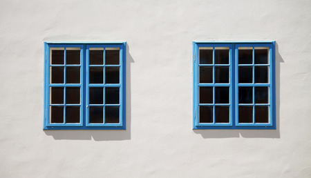 softwood: Two windows on the wall Stock Photo
