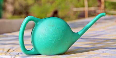 wateringcan: Green watering-can Stock Photo