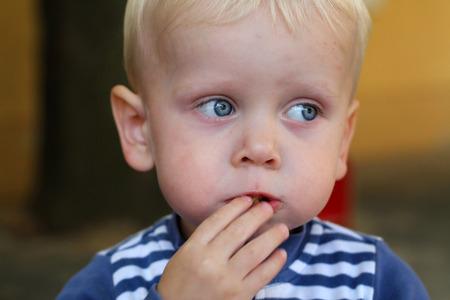 smeary: The boy enjoys his food