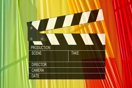 clapperboard icon against multicolored background