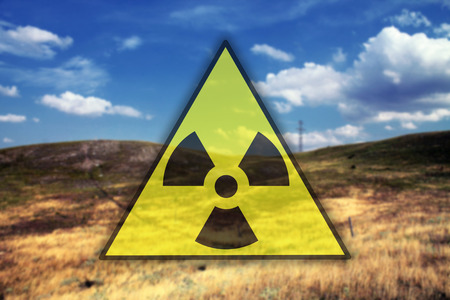 nuclear sign: Nuclear sign against landscape background