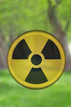 Radioactive sign against landscape background Reklamní fotografie