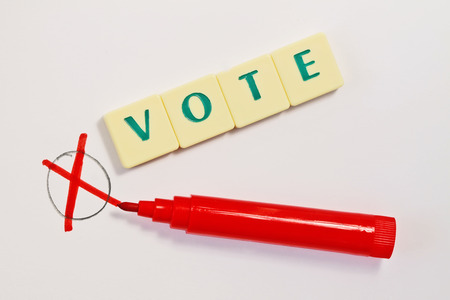 red pen: Vote mark and red pen Stock Photo