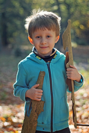 A boy playing in forest