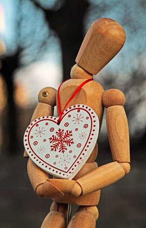 The puppet hangs around in his neck a Christmas tree ornament Reklamní fotografie