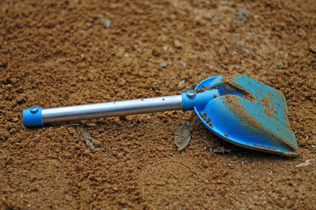 Blue spade in the sandpit