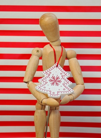 pineal: The puppet hangs around in his neck a Christmas tree ornament Stock Photo