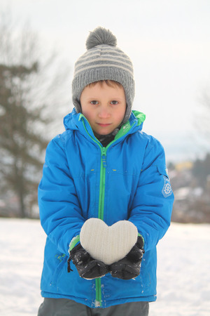white boy holds heart Standard-Bild