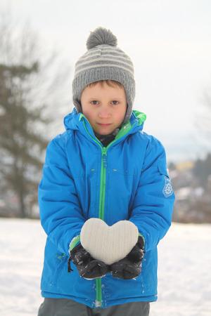 white boy holds heart Reklamní fotografie