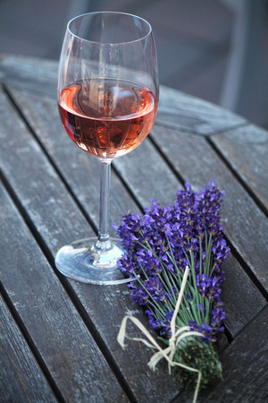 lavender and a glass of wine Reklamní fotografie