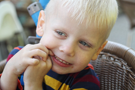 Smiling boy with blond hair