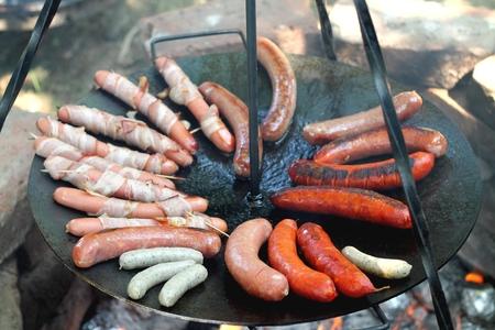 baking sausages at the campfire Reklamní fotografie - 46792129
