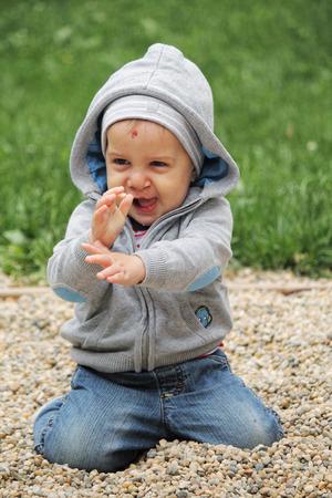 Playying boy with clip left Reklamní fotografie