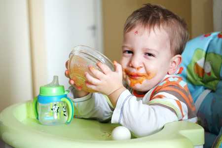 Boy eats some soup left with clip Reklamní fotografie - 52360272