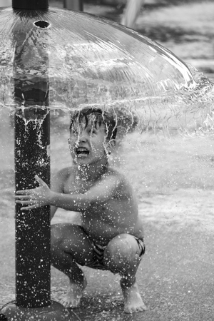 The boy plays with water