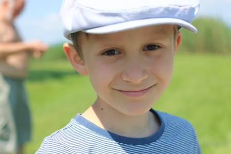 The smiling boy with hat