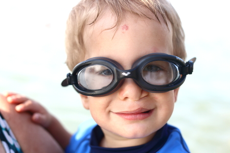 Happy boy with glasses clip left and swimmer