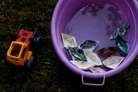 Paper toy boat and tractor