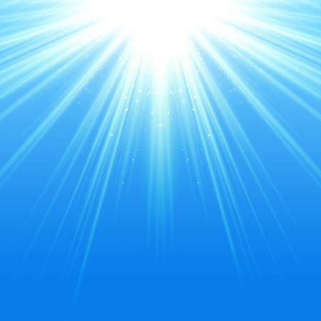 radiate: Blue sky with glaring sun Stock Photo