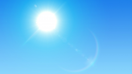 Blue sky with glaring sun Stock Photo