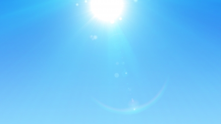 Blue sky with glaring sun photo