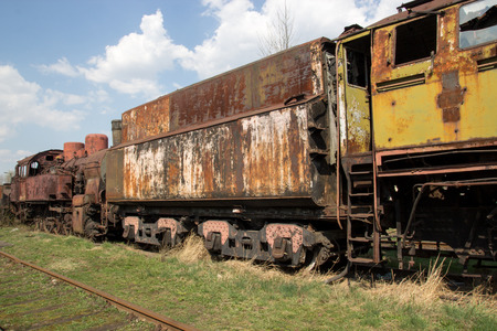Old rusty locomotives and cars Stock Photo
