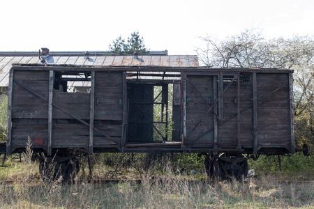 Old wooden ruined boxcar Stock Photo