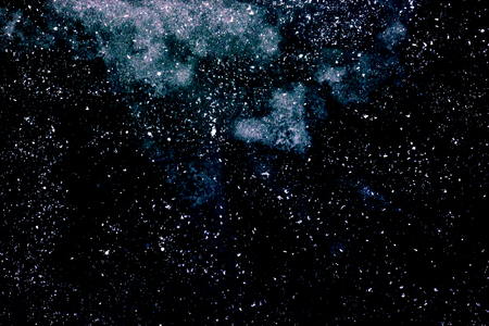 Abstract dark blue background with white spots, deep space with many stars and galaxies