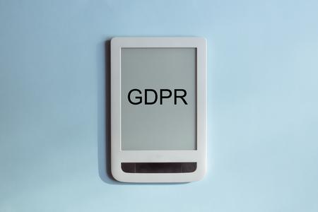 GDPR - White tablet on a blue pastel background 版權商用圖片