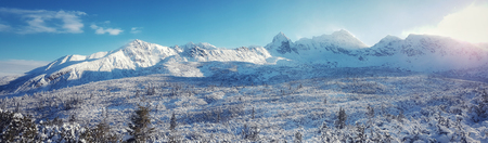 Beautiful panorama of snow-capped mountain range , the sun shines in the morning Stock fotó