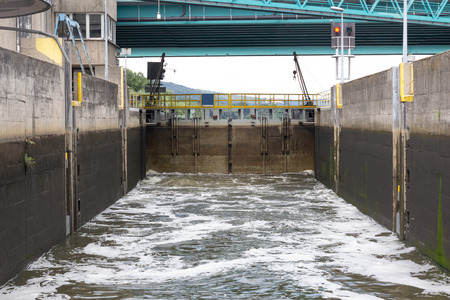 Water lock Filling the water on the river, the view from the inside