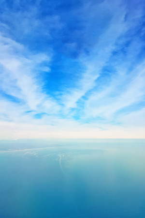 Breathtaking view of the sky and clouds from the window of a flying plane