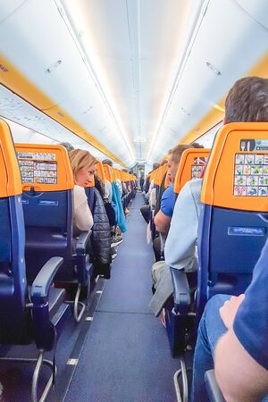 ROME, ITALY - APRIL 09, 2019: People on the board of Ryanair Plane Éditoriale