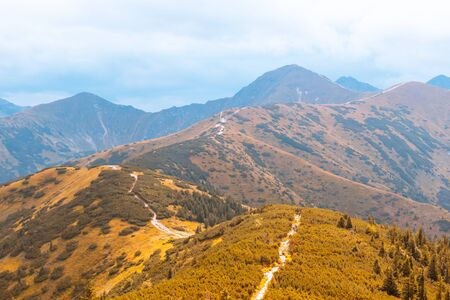 Beautiful autumn mountain landscape, against the blue sky, the concept of autumn mountain tourism Stok Fotoğraf